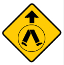 Yellow diamond with arrow and walking legs sign
