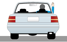 Illustration showing a driver signalling that they are stopping or slowing by placing their right out of the drivers side window with the elbow bent and the hand straight up