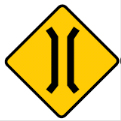 Yellow diamond with two parallel indented lines sign