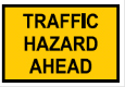 Yellow rectangle with the words Traffic Hazard Ahead sign