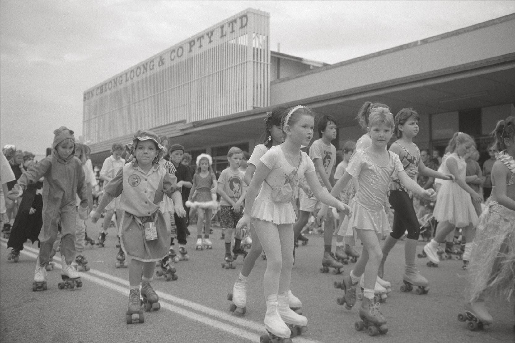 Bougainvillea parade, roller skaters on Knuckey Street Darwin, 2 June 1990<br />Image courtesy of Library & Archives NT,  Department of the Chief Minister, NTRS 3823 P1, Box 11, BW2910, Image 22
