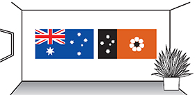 Image of the Australian and the NT flags hanging next to each other on a wall.